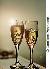 wedding rings inside a glass with champagne - Alcohol,...