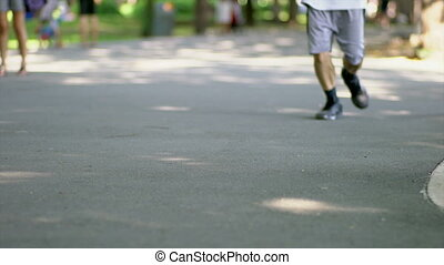 People jogging In the Park, shallow DOF, low angle view