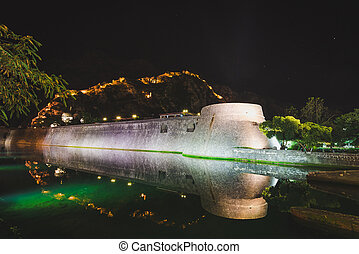 Kotor Old Town by Night - Kotor fortress wall and Old Town...