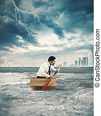 Paddling in the storm - Businessman surfs on a cardboard...