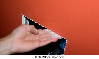 Mounting white plastic inspection door in plasterboard wall...