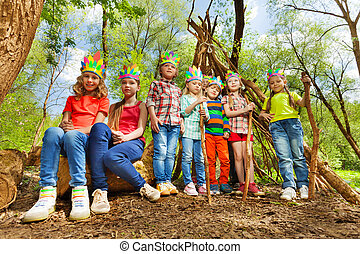 Happy kids in Injun's costumes playing at the park - Big...