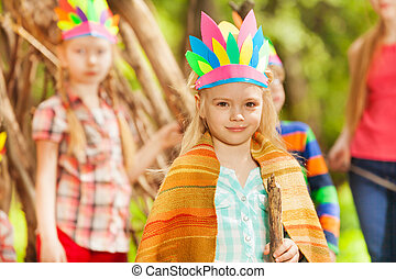 Blond girl in Injun's costume playing with friends -...