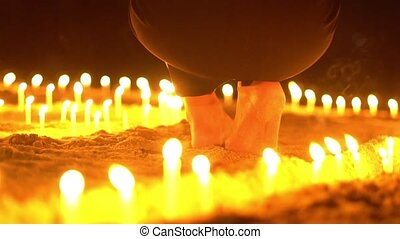 Asian candles on sand in religious ceremony , windy. Slow...