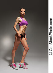 Full height portrait of woman with dumbbells
