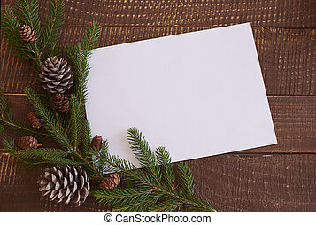 Piece od paper with branch and pine cones