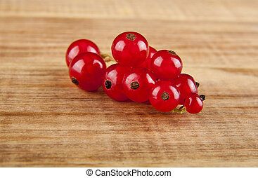 currants on a wooden background closeup