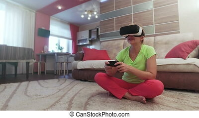 Beautiful woman with virtual reality helmet are playing...
