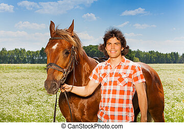 Portrait of happy man with his beautiful bay horse