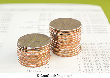 Coin stack on account book bank
