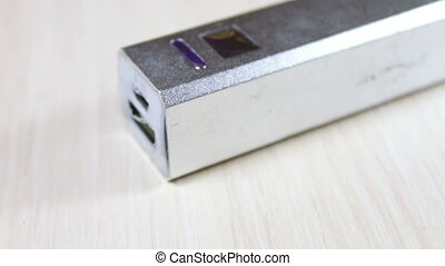 silver coloured powerbank in which to insert and remove the...