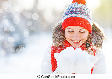 happy woman blowing snow in winter nature - happy woman is...