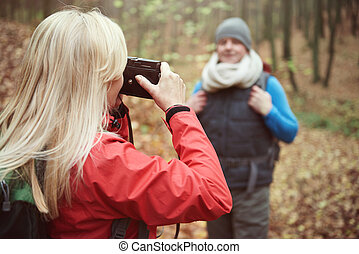 Woman taking picture of her husband