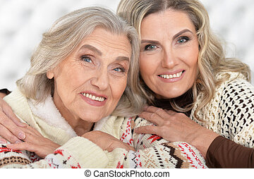 Senior woman with daugther - Portrait of smiling senior...