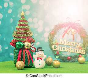 Christmas tree with snowman background. retro color effected