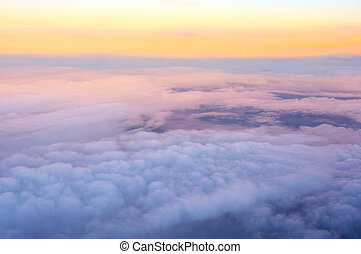 View above clouds - View from aircraft above clouds at...