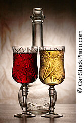Wine and bottle in dark - Glass and bottle wine on wooden...