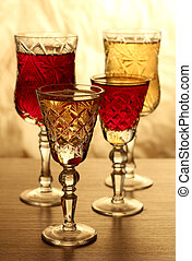 Wine glass on wooden table - Glass and bottle wine on wooden...