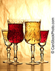Wineglass in dark - Glass and bottle wine on wooden table