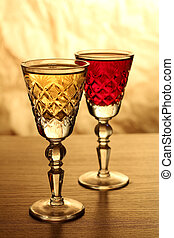 Wineglass on wooden table - Glass and bottle wine on wooden...