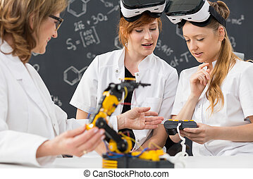 Working on virtual reality - Shot of two students wearing...