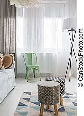 Upholstered stools and pattern carpet - Light room with...