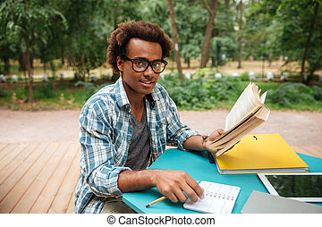 Happy african man studying outdoors - Happy attractive...