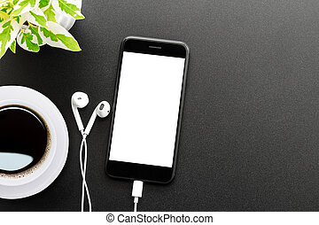phone and headphones on table top view