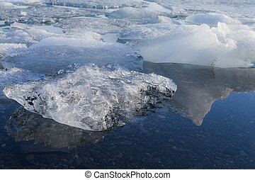 Ice breaking in Jakulsarlon lagoon, close up, Iceland winter...