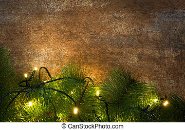 Christmas tree and lights on rusty background