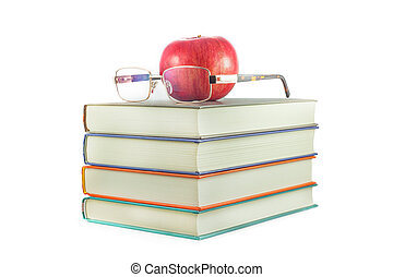 books with red apple and glasses on a white background.