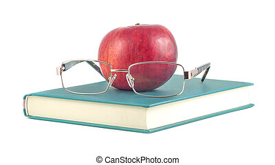 book with red apple and glasses on a white background.