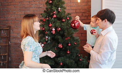Happy Family Decorating Christmas Tree red balls