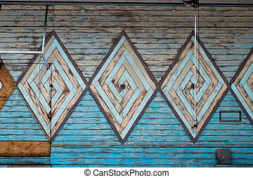 Old wooden wall with a pattern of diamond-shaped