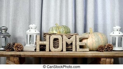 Letters drawn up in the form of the word HOME with pumpkins,...