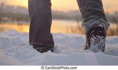 Man traveler trekking in wintertime cold snowy weather, men...