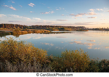 Pond in countryside in autumn at sunset - Pond in the...