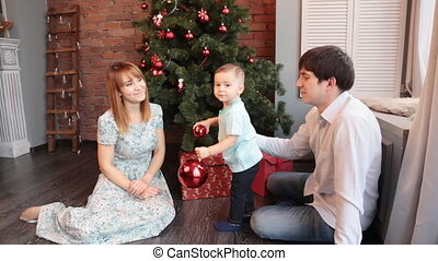 Christmas family portrait in home holiday living room red...
