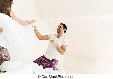 Couple having fun in bed