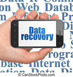 Data concept: Hand Holding Smartphone with Data Recovery on...