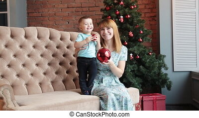 Happy mother and little son celebrate Christmas