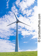 windmill on dike - large wind turbine against a typical...