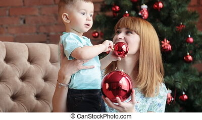 Happy mother and little son celebrate Christmas - Portrait...