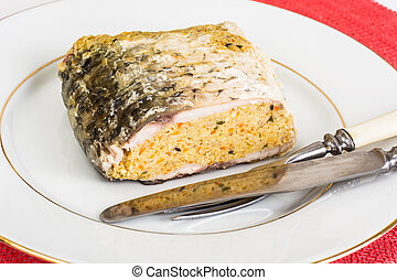 Traditional Jewish passover food gefilte fish with carrots, pars