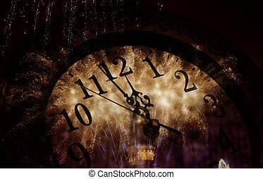 New Year's at midnight - old clock with fireworks and...