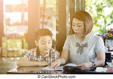 Mother reading a book with her son