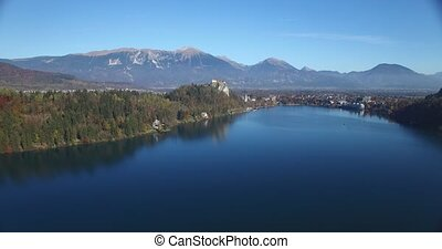 Aerial view of Bled Castle and Bled lake landscape with mountain