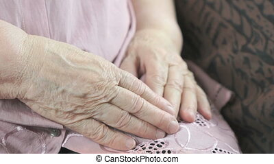 Flabby wrinkled skin of an old woman. Close up