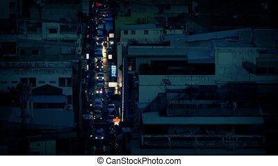 Cars Light Up Avenue At Dusk In City - High angle view of...