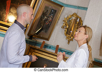artists in gallery discussing an exhibition
